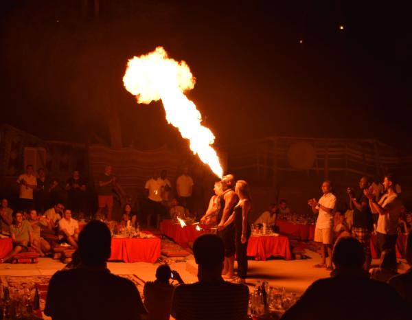 Fire Dancer in Desert Camp